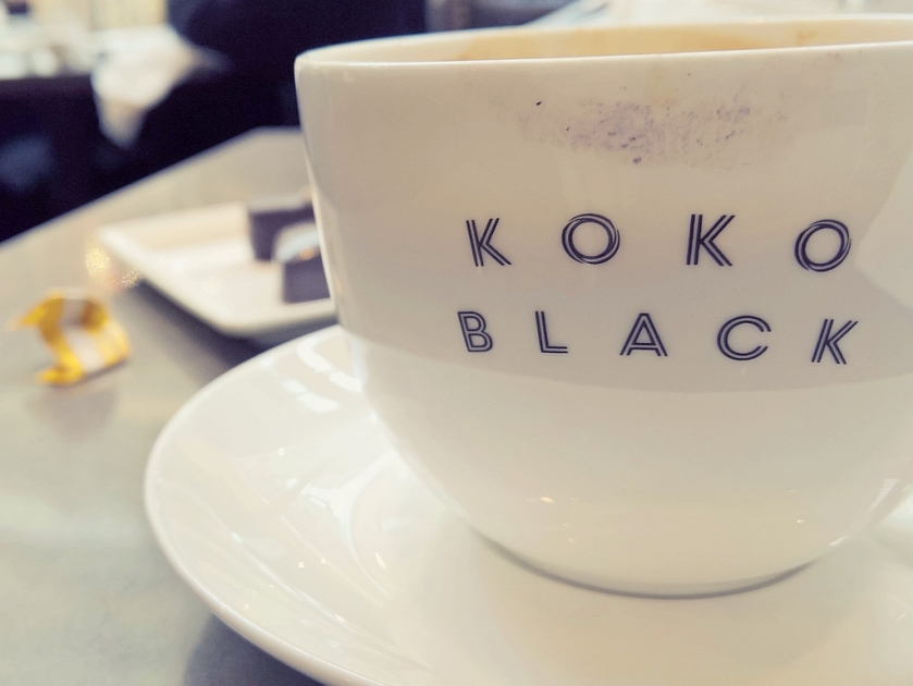 Koko Black fine porcelain cup and saucer, with smudgy lipstick. Lumia Creative Studio.